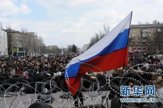 ▲资料图:2014年,乌克兰东部顿涅茨克州的亲俄民众举行抗议集会。