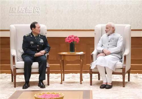 ▲8月21日下午,印度总理莫迪在新德里会见了到访的中国国务委员兼国防部长魏凤和。李晓伟 摄