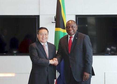 中国银行董事长陈四清与南非总统拉马福萨在京会面